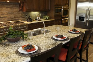 Luxurious kitchen with granite counter tops.