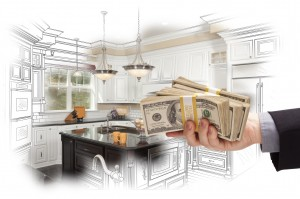 Hand Holding Cash Over Kitchen Design Drawing and Photo
