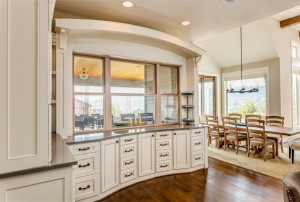 Hardwood floors and beautiful cabinetry highlight this stunning kitchen/dinign area